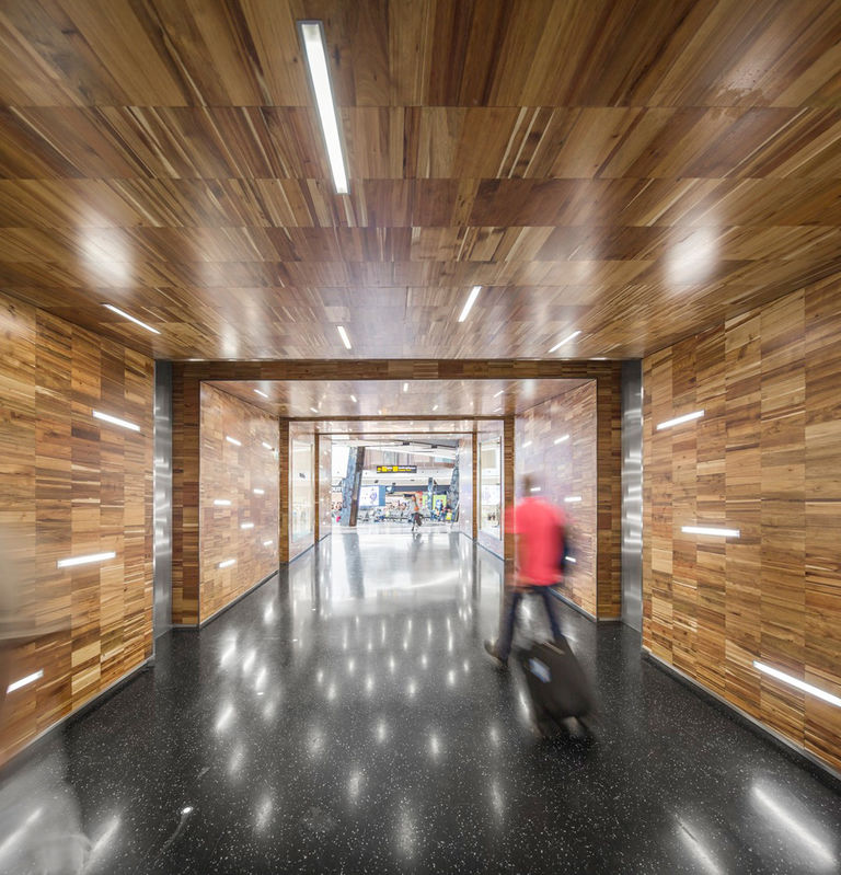 New timber interior finishes at newly refurbished Lisbon International Airport, Portugal.