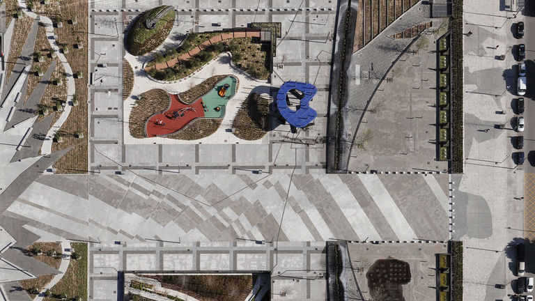Aerial view of Las Cuato Torres plaza, inspired by Picasso's Guernica painting