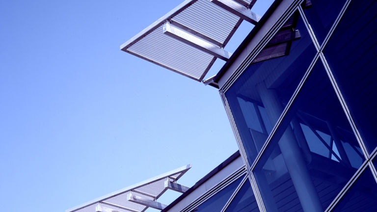 Saw-tooth roof detail, clad in photovoltaic panels, at BP International Centre for Business and Technology in Sunbury.
