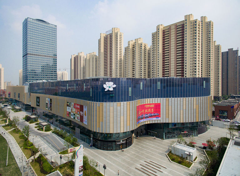 Photo showing contrasting styles of office building and retail block at ID Mall in Hefei, China.