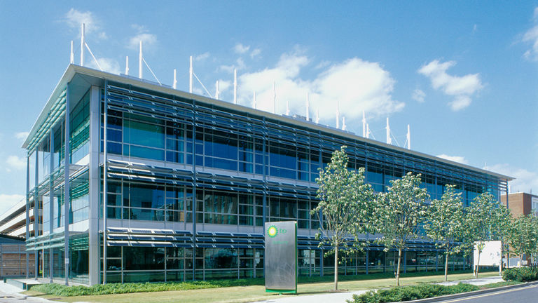 External façade of link building at BP International Centre for Business and Technology, Sunbury campus, featuring photovoltaic panels.