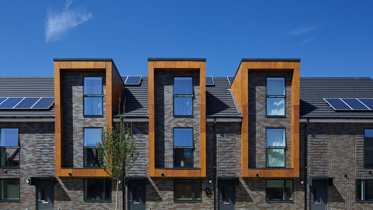 External facade detail and photovoltaic panels at Erith Park, London Borough of Bexley.