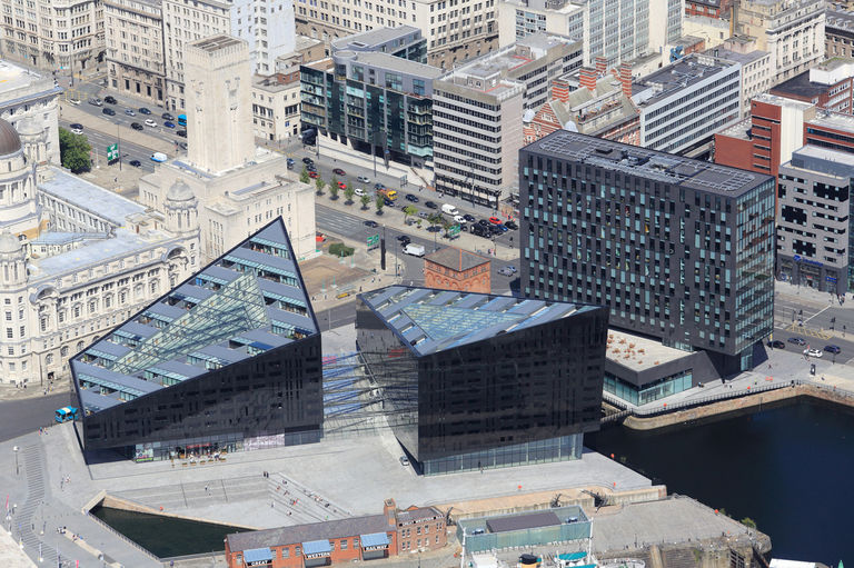 Aerial view of the Mann Island scheme, showing two triangulated new residential buildings and a third commercial block.